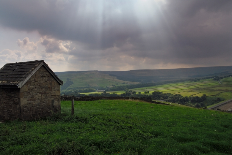 A rain cloud over the tops of the moors, Holmfirth on the South Pennines, West Yorkshire.