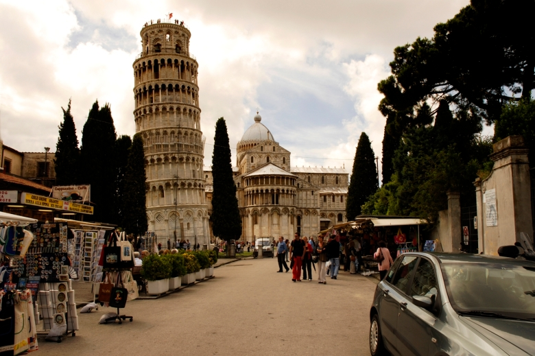 """City of Pisa and it's leaning tower from the main street of Pisa """"not normally seen from this angle"""""""