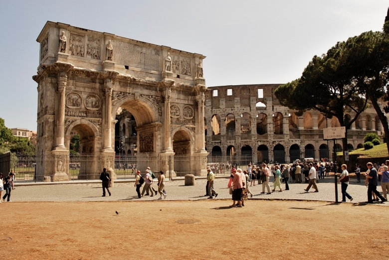 The cobbled road to the Arch of Titus. The Arch of Constantine and the Colosium