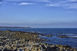BURGHEAD. SEA SHORE Lighthouse in the distance