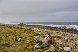 BURGHEAD. SEA SHORE Lighthouse in the distance on a very wet and windy day.