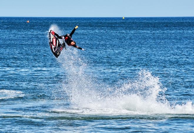 World champion Jet Ski stunt man exhibits his skills before the main event.