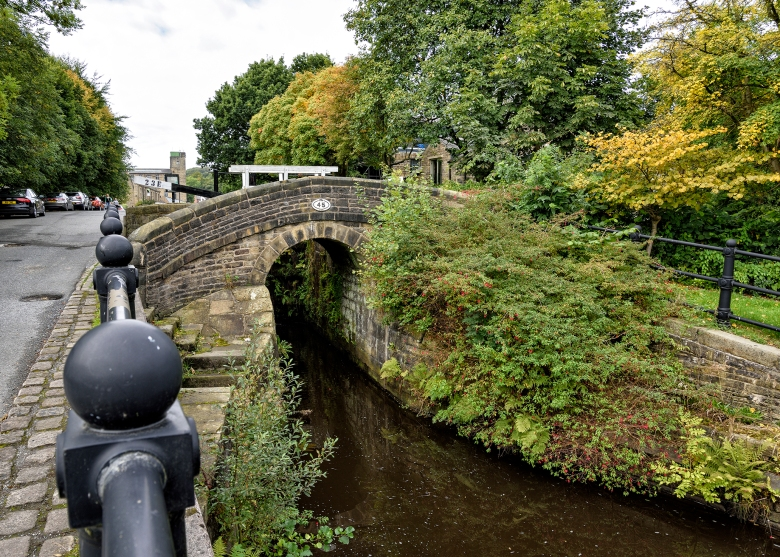 Huddersfield Narrow Canal and Packhorse Bridge at Slaithwaite